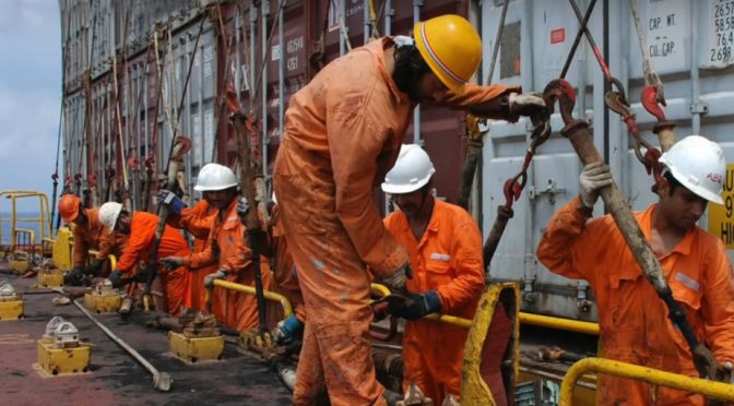 Seafarers working on a ship